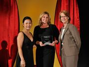 Carli Amlin Dean accepts the 2013 Forty Under 40 award alongside Dean Joanne LI of Wright State University, the title sponsor, and DBJ Publisher Carol Clark.