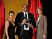 Stephen Hightower II accepts the 2013 Forty Under 40 award alongside Dean Joanne LI of Wright State University, the title sponsor, and DBJ Publisher Carol Clark.