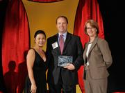 Horton Hobbs IV accepts the 2013 Forty Under 40 award alongside Dean Joanne LI of Wright State University, the title sponsor, and DBJ Publisher Carol Clark.