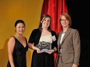 Laura Estandia accepts the 2013 Forty Under 40 award alongside Dean Joanne LI of Wright State University, the title sponsor, and DBJ Publisher Carol Clark.