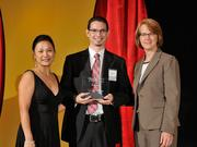 Ryan Hoffman accepts the 2013 Forty Under 40 award alongside Dean Joanne LI of Wright State University, the title sponsor, and DBJ Publisher Carol Clark.