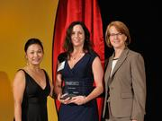 Tabitha Justice accepts the 2013 Forty Under 40 award alongside Dean Joanne LI of Wright State University, the title sponsor, and DBJ Publisher Carol Clark.