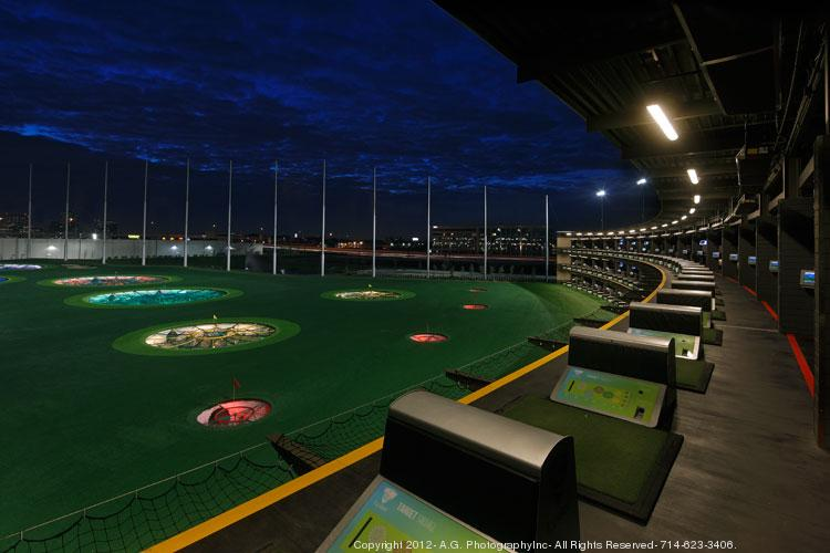 Top Golf facilities are surrounded by tall fences.