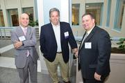 Philadelphia Business Journal Editor Craig Ey with attendees at the 40 Under 40 awards dinner.