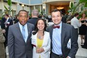 Philadelphia Business Journal Advertising Director Ron Maver with attendees at the 40 Under 40 awards dinner.