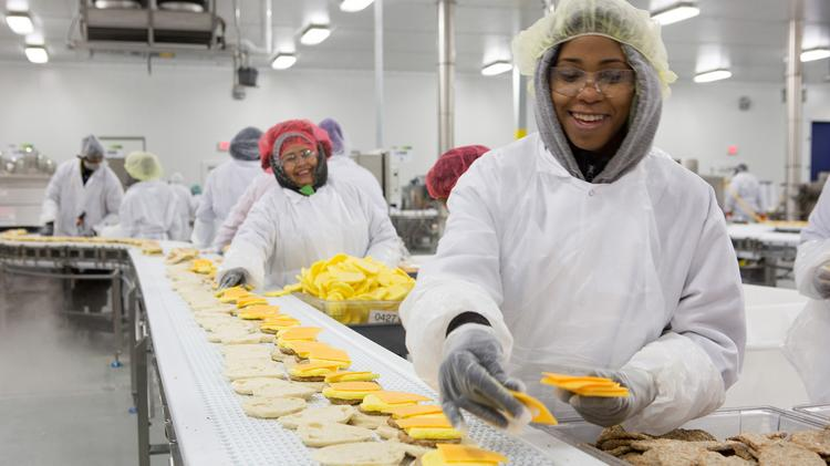 SK Food Group employees assemble sandwiches on the line at the company's facility in Groveport.