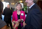 Honoree Denise Resnick of DRA Strategic Communications visits with Steve Seleznow.