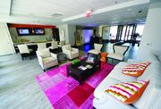 The lounge, located off of the front lobby at The Brix@26 .