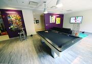 A billiards table is featured in the gaming lounge at The Brix@26 on the South Side.