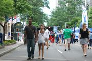 Speed Street draws quite a varied crowd, including race fans, uptown party-goers, families and professionals who leave their offices in the area to stroll through the festival.