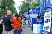Attendees line up for games and chances to win freebies and coupons.