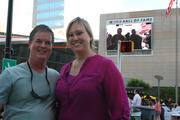 Speed Street attendees pause for a photo near the NASCAR Hall of Fame.