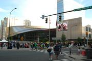 A crowd is gathered near the NASCAR Hall of Fame during Speed Street performances.