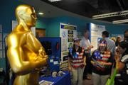 Representatives of United Trophy MFG Inc. speak with attendees of OBJ's 2013 Business Growth Expo in the Orlando Science Center.