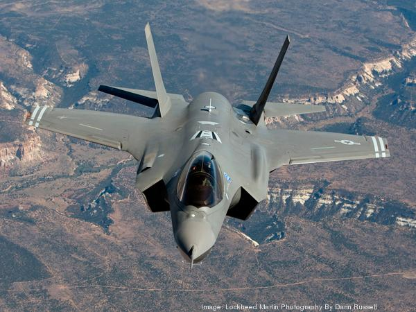 Delays in production of Lockheed Martin Corp.'s F-35 fighter aircraft has  contributed to major cost increases and schedule delays for the $43 billion Navy program to build three aircraft carriers, and could eventually lead to pricey retrofits to the initial ship after it's delivered.