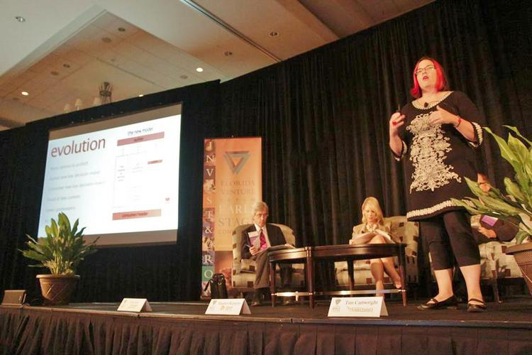 Kristen McLean with Bookigee makes a presentation at the Florida Venture Forum's Early Stage Conference.