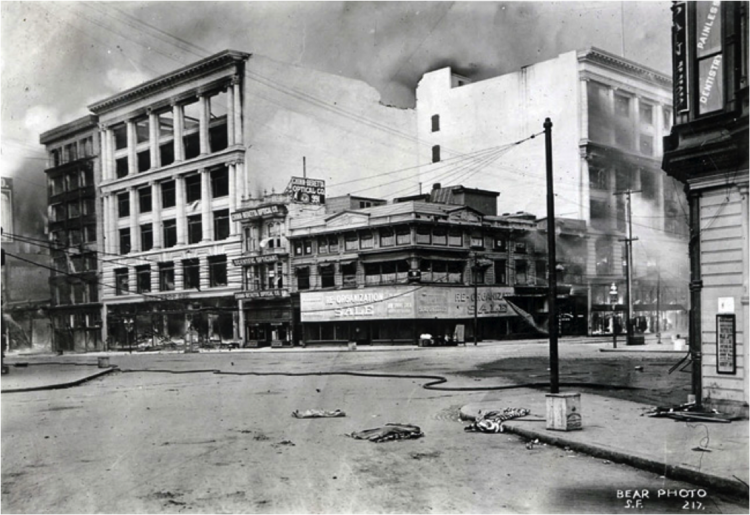 Market and 6th Street, Looking E, c. 1906, just after earthquake while fires are burning nearby (Wilson Building is at the far left).