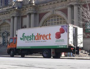 A FreshDirect truck makes a stop in New York City. The online grocer is fighting a lawsuit aimed at stopping construction of a new facility in the South Bronx.