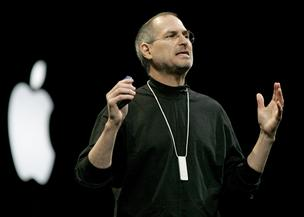 Steve Jobs, CEO of Apple Computer Inc., wears an iPod Shuffle around his neck during his keynote at the Macworld Conference and Expo in San Francisco, California on January 11, 2005.
