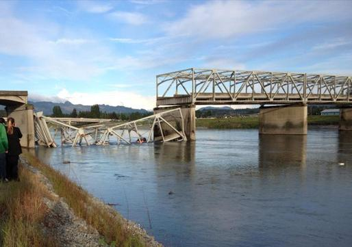 The overhead steel frame of the I-5 bridge over the Skagit River is shaped like an arch, leaving little clearance for tall vehicles.