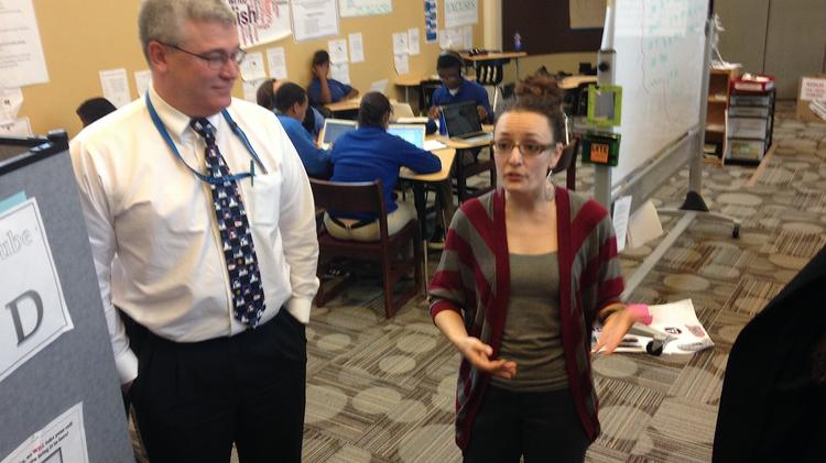 Hank Stopinski, principal of Health Sciences Charter school, and Nicole Carrol, a teacher, explain the school's new Center for Innovation digital lab.