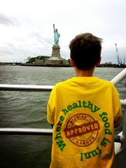 Nicolas Come, the 8-year-old entrepreneur behind a mobile app and a digital platform for kid-friendly healthy recipes, takes in a view of the Statue of Liberty in New York Harbor after filming his segment on national television earlier in the day.