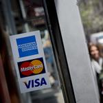 Apple woos credit cards for mobile wallet; U.S. firms feel targeted in China; Dollar General ups Family Dollar bid (Video)