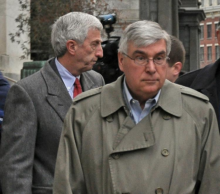 David Smith and Timothy McGinn exit the federal courthouse during their criminal trial.