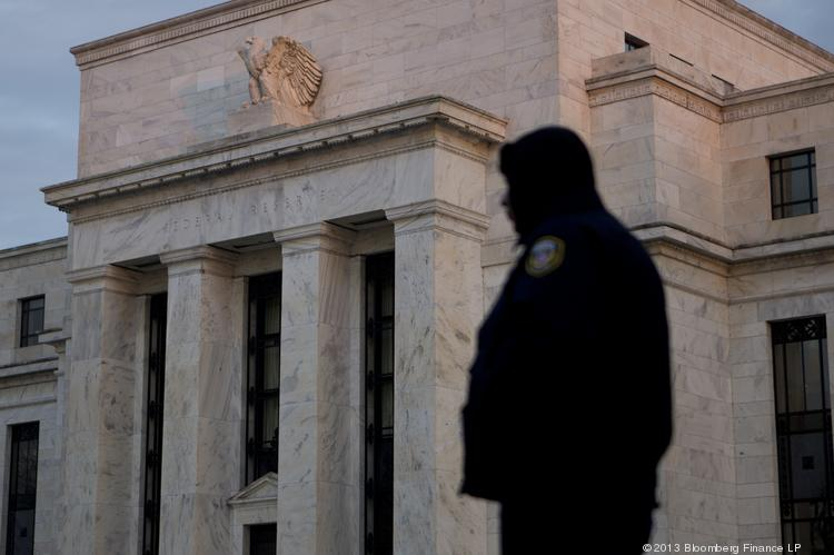 The Federal Reserve will dial back its purchase of Treasury bonds and mortgage-backed securities in January.