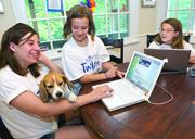 """The Wolf sisters, Maddie, left, Abby, and Julia, enjoy socializing on the """"tween"""" website iTwixie.com, created by their mother Rebecca Gaynier."""