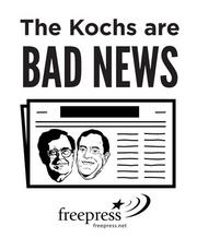 Signs protest opposition to the Koch Brothers alleged interest in Tribune Co. newspapers.