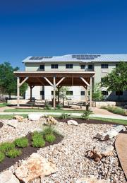 An extended-stay hotel was transformed by Foundation Communities into this environmentally sensitive multifamily property for low-income adults.