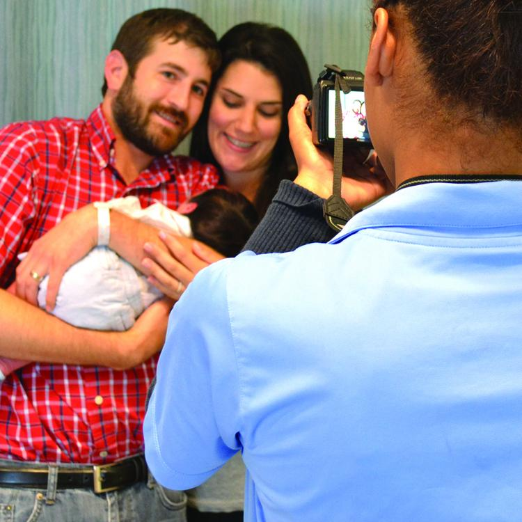 Biovideo videographer Yasmine Fontanez films the Wallace family in Baptist St. Luke's hospital shortly after the birth of their first child.