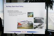"""Although tolls will help fund the bridges project, this poster noted the plans for """"no stop"""" tolling."""