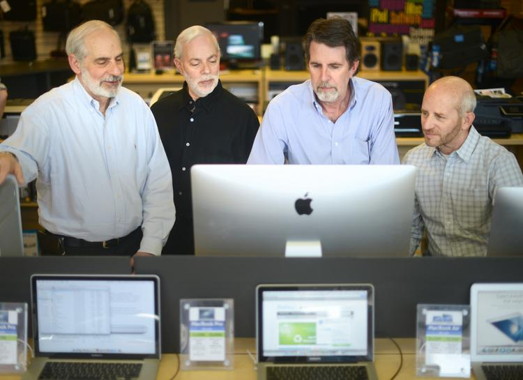 From left: FirstTech owners Rick Zuckman, Arnie Zuckman, Pete Paulsen and Harvey Zuckman. The store has focused on Apple products since 1987.