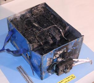 NTSB photos of the burned auxiliary power unit battery from a JAL Boeing 787 that caught fire on Jan. 7 at Boston's Logan International Airport. The dimensions of the battery are 19x13.2x10.2 inches and it weighs approximately 63 pounds (new).