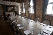 A second-floor private dining room is window lit during the daylight hours.