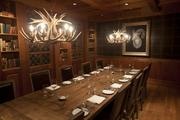 A second-floor private dining room has a distinctly masculine feel.