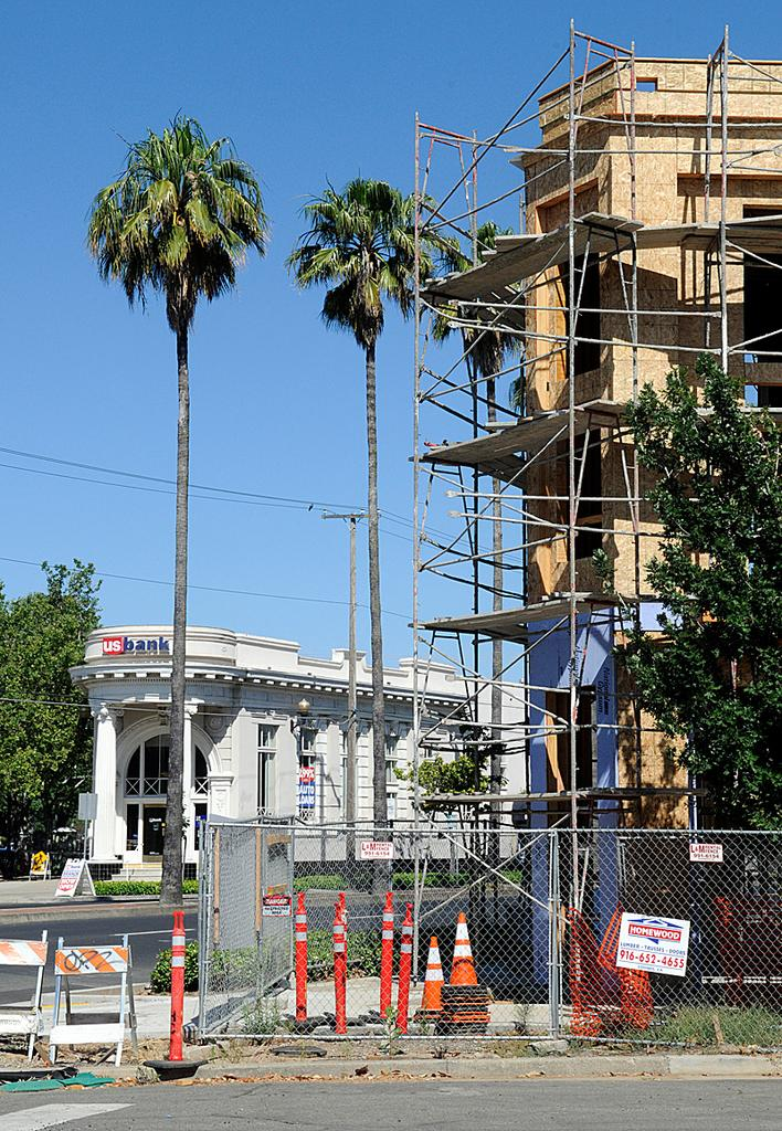 A mixed-use project called the Broadway Triangle is under construction in Sacramento's Oak Park neighborhood. The once-troubled district is seeing a surge in interest in redevelopment.