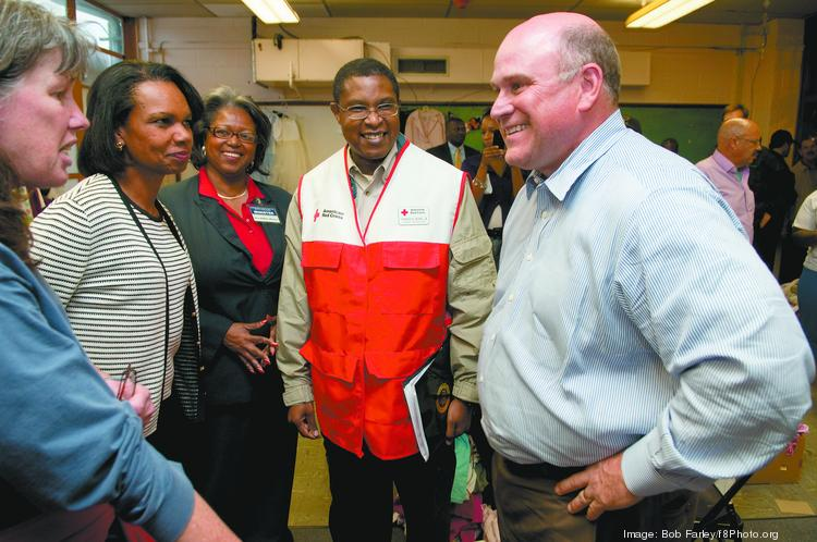Regions Financial Corp. CEO Grayson Hall, right, and Condoleezza Rice, second from the left, visit a school following the April 2011 tornadoes. Rice will appear at a panel on civil rights hosted by Regions.