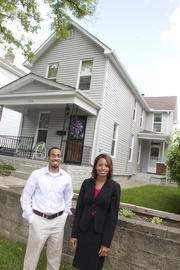 Robert Williams and Angela Mingo of Nationwide Children's Hospital's community relations department help coordinate the South Side Renaissance Home Repair Program. This home on Woodrow Avenue benefited from the program.