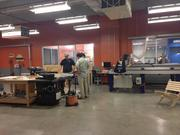 The facility includes a wood working room with a wood lathe and CNC routers.