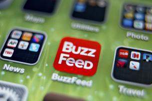 An icon for the BuzzFeed app is photographed on the home screen of an Apple Inc. iPhone 5 in Tiskilwa, Illinois, U.S., on Thursday, May 30, 2013. N