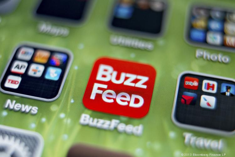 An icon for the BuzzFeed app is photographed on the home screen of an Apple Inc. iPhone 5 in Tiskilwa, Ill., on Thursday. New York Times Co., looking to imitate the business models used by startups such as BuzzFeed, is considering letting advertisers sponsor more stories on its website, two people with knowledge of the situation said.