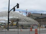 A look at progress on construction at and around Denver Union Station, shot May 25, 2013.  The white framework is the supporting structure for a canopy that will cover the rail platform.