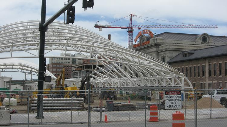 A look back at progress on Denver Union Station's transportation center as it appeared on May 25, 2013. The white framework is the supporting structure for the canopy that now covers the rail platform.