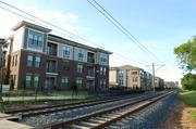 The site Morgan Group is considering is on the other side of the light rail tracks from  Junction 1504, a 218-unit project by JLB Partners.