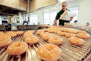 Story: Krispy Kreme giving Houston a second try with major market push Story: Franchisee hungry to bring Krispy Kreme back to Houston  Pictured: Kevin Hoeing, general manager of the flagship Krispy Kreme store in Winston-Salem, N.C., preparing to box freshly glazed doughnuts in 2002.