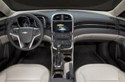 The 2014 Chevrolet Malibu's redesigned center console has a longer armrest, providing greater comfort and storage room for two cell phones and a pair of cup holders.