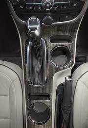 The 2014 Chevrolet Malibu's redesigned center console provides storage room for two cell phones and a pair of cup holders.